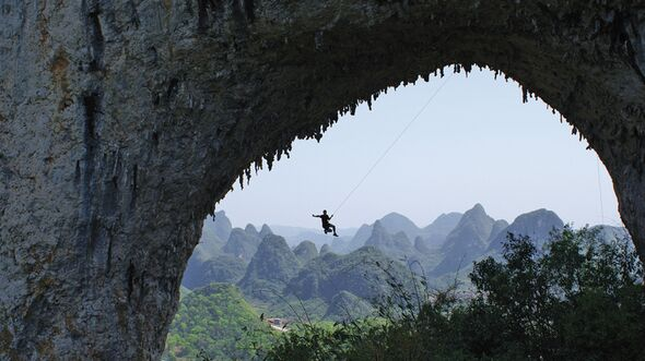 KL-Yangshuo-Swinging-high-on-Moon-Hill-arch (jpg)
